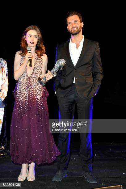 Actress Lily Collins receives Best Actress from producer Andrea Iervolino of AMBI during the 2017 Ischia Global Film Music Fest on July 15 2017 in...