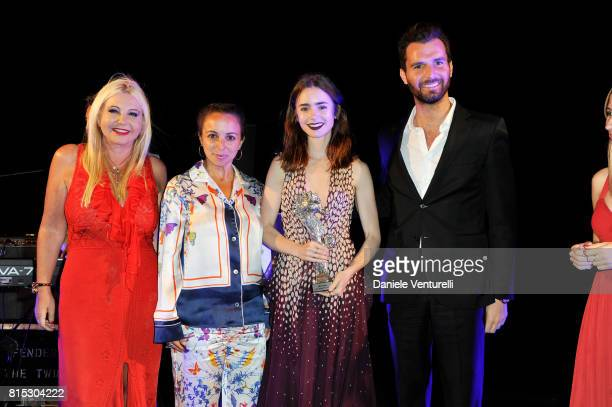 Actress Lily Collins receives Best Actress from producer Lady Monika Bacardi and Andrea Iervolino of AMBI during the 2017 Ischia Global Film Music...