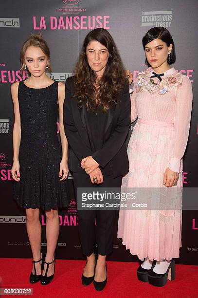 Actress LilyRose Depp Director Stephanie Di Giusto and actress Soko attend the La Danseuse Paris Premiere at Cinema Gaumont Opera on September 19...