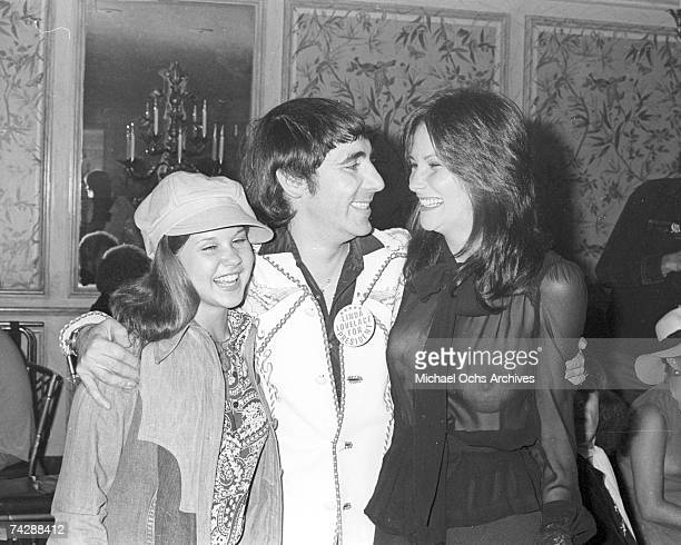 Actress Linda Blair drummer Keith Moon of the rock and roll band The Who and porn star Linda Lovelace hang out at Keith's 28th birthday party on...