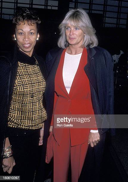 Actress Linda Evans and Altovise Davis wait to board flight to Washington DC for the Housing Now March on October 6 1989 at the Los Angeles...