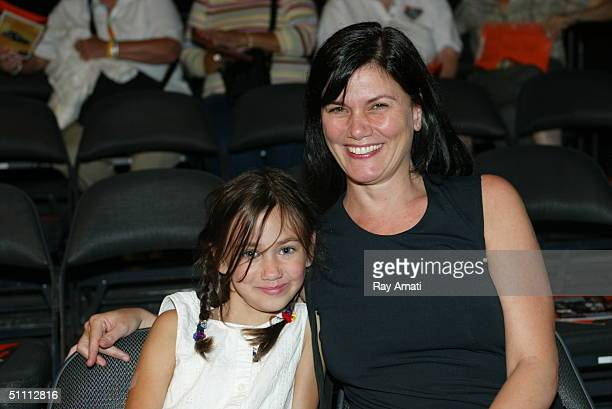 Actress Linda Fiorentino an her niece Lillyann watch the New York Liberty take on the Detroit Shock at Radio City Music Hall on July 24 2004 in New...
