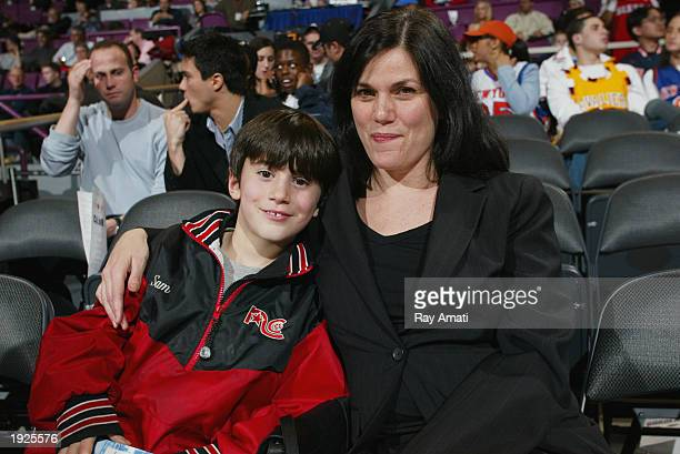 Actress Linda Fiorentino with nephew Sam sit courtside as the Philadelphia 76ers visit the New York Knicks on April 11 2003 at Madison Square Garden...