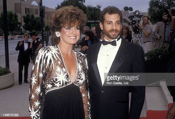 Actress Linda Gray and date Paul Constanzo attend the 36th Annual Primetime Emmy Awards on September 23 1984 at the Pasadena Civic Auditorium in...