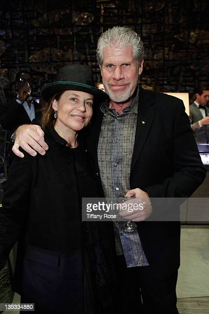 Actress Linda Hamilton and actor Ron Perlman attend the Opal Stone Luxury Handbags And Fine Jewelry Launch at Gray Gallery on December 8 2011 in...