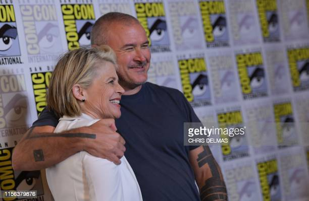 Actress Linda Hamilton and director Tim Miller arrive for the Terminator Dark Fate red carpet event at the Hilton Bayfront during Comic Con in San...