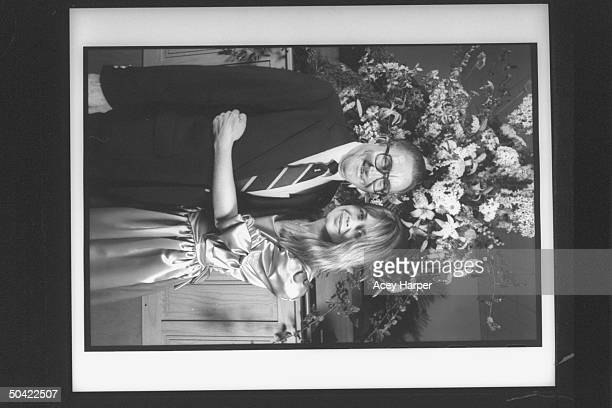 Actress Linda Hamilton hugging unidentified older man at wedding of actor friend John Voldstad