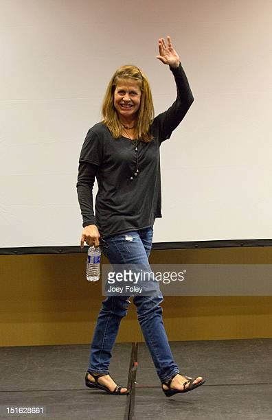 Actress Linda Hamilton waves to the crowd leaving a QA as she attends the Horrorhound Weekend Day 2 at Marriott Indianapolis on September 8 2012 in...