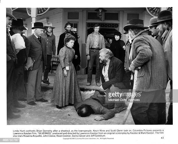 "Actress Linda Hunt and actor Brian Dennehy on set the movie ""Silverado"" circa 1985."