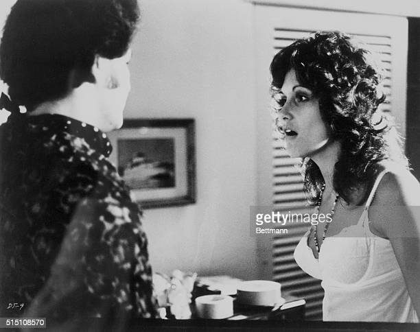 Actress Linda Lovelace talking to another actor in the 1972 pornographic film Deep Throat