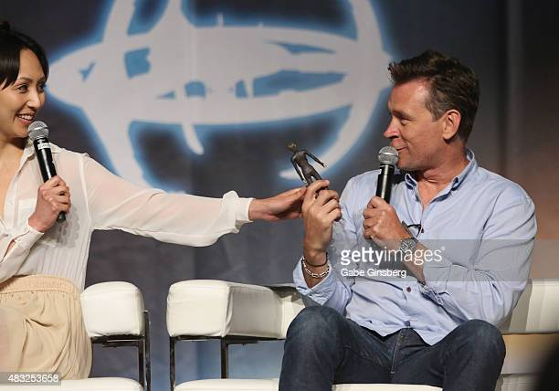 Actress Linda Park jokes around with actor Connor Trinneer as they speak during the Star Trek Enterprise panel at the 14th annual official Star Trek...