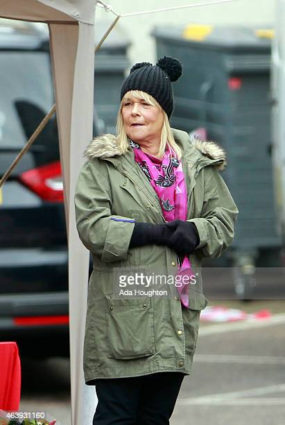 Actress Linda Robson is pictured filming a new advert where the actress can be seen giving away flowers in a petrol station on February 18 2015 in...