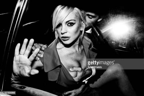 Actress Lindsay Lohan and actor Spencer Falls at a photo shoot on July 12 2011 in Los Angeles California