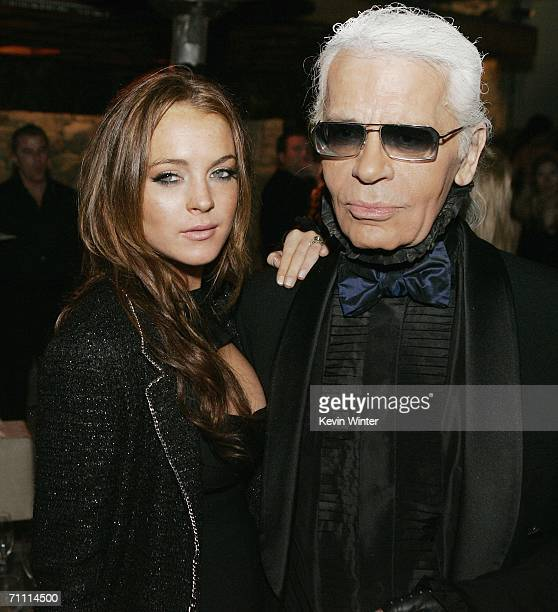 Actress Lindsay Lohan and designer Karl Lagerfeld pose at the International Launch of Dom Perignon Rose Vintage 1996 Champagne by Karl Lagerfeld on...