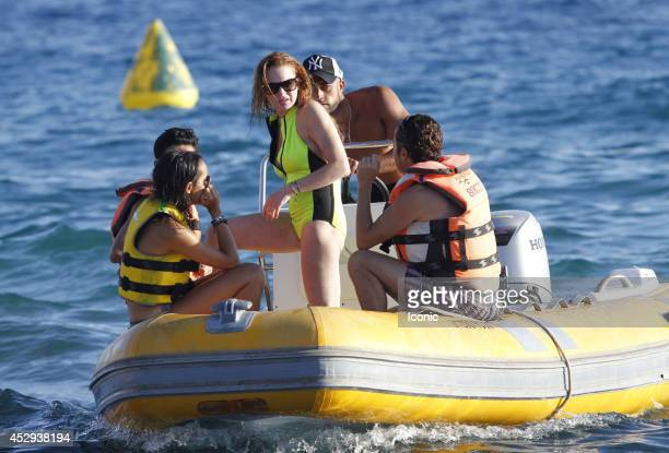 Actress Lindsay Lohan and friends sighted in a dingy on July 30 2014 in Ibiza Spain