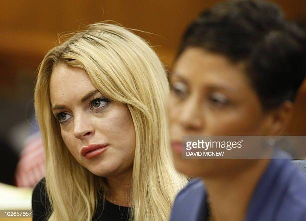 US actress Lindsay Lohan and her lawyer Shawn Chapman Holley during her hearing at the Beverly Hills Courthouse on July 6 2010 Lohan was arrested in...