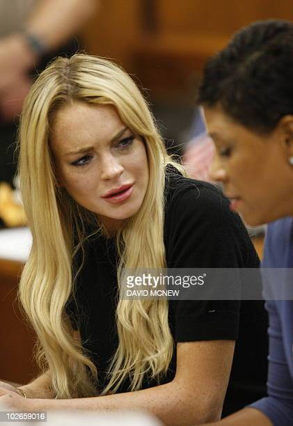 US actress Lindsay Lohan and her lawyer Shawn Chapman Holley listen to Judge Marsha Revel during her hearing at the Beverly Hills Courthouse on July...