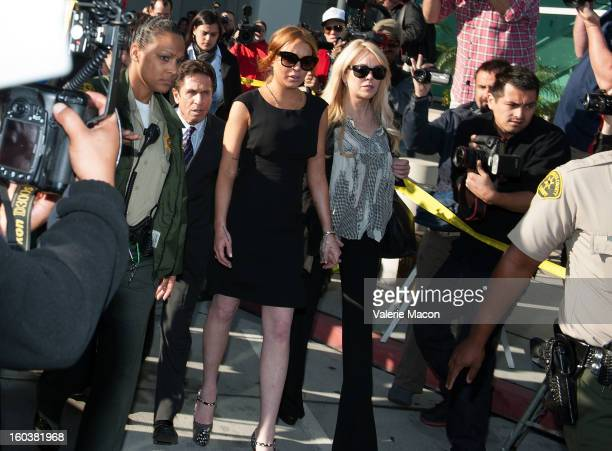 Actress Lindsay Lohan and her new lawyer Mark Heller and her mother Dina leave the Airport Branch Courthouse of Los Angeles Superior Court on January...