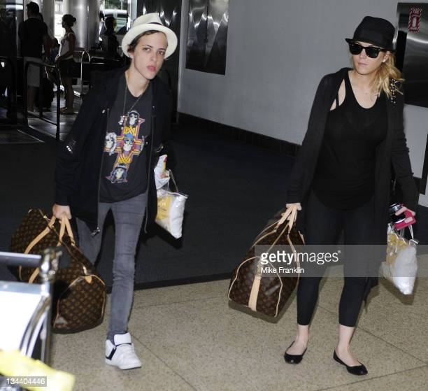 Actress Lindsay Lohan and Samantha Ronson arrive at the Miami International Airport on August 6 2008 in Miami Florida