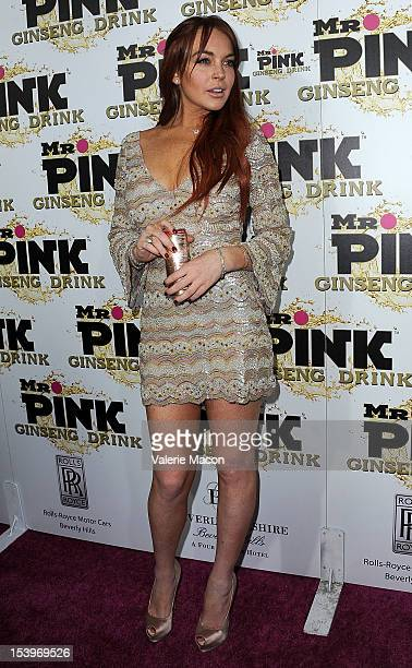 Actress Lindsay Lohan arrives at Mr Pink Ginseng Drink Launch Party on October 11 2012 in Beverly Hills California