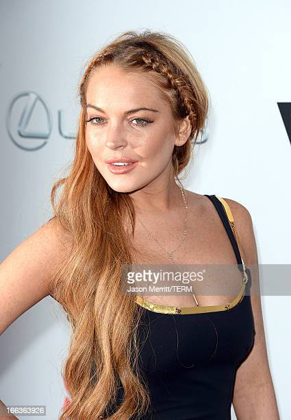 Actress Lindsay Lohan arrives at the Dimension Films' Scary Movie 5 premiere at the ArcLight Cinemas Cinerama Dome on April 11 2013 in Hollywood...