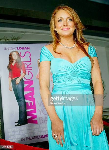 Actress Lindsay Lohan arrives at the premiere of Paramount's 'Mean Girls' at the Cinerama Dome on April 19 2004 in Los Angeles California