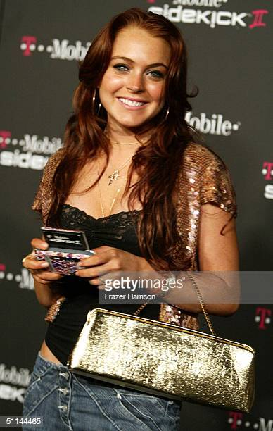 Actress Lindsay Lohan arrives at the T-Mobile Sidekick II Launch Party held at the Grove on August 4, 2004 in Hollywood, California.