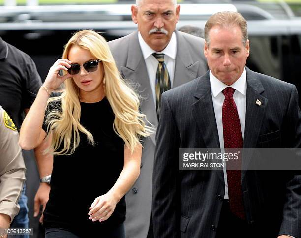 US actress Lindsay Lohan arrives for a probation violation hearing at the Beverly Hills Courthouse on July 6 2010 Lohan was arrested in 2007 and...