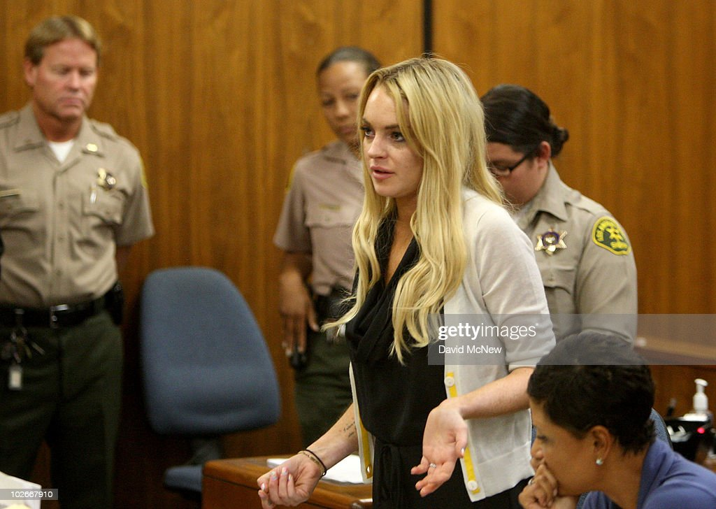 Actress Lindsay Lohan attends her probation revocation hearing at the Beverly Hills Courthouse on July 6, 2010 in Los Angeles, California. Lindsay Lohan was found in violation of her probation for the August 2007 no-contest plea to drug and alcohol charges stemming from two separate traffic accidents, she is scheduled to surrender on July 20, 2010 to serve her 90 day jail sentence.