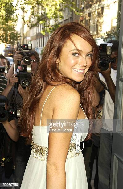 Actress Lindsay Lohan attends the lowkey premiere screening of 'Mean Girls' at the Charlotte Street Hotel on June 14 2004 in London The film is about...