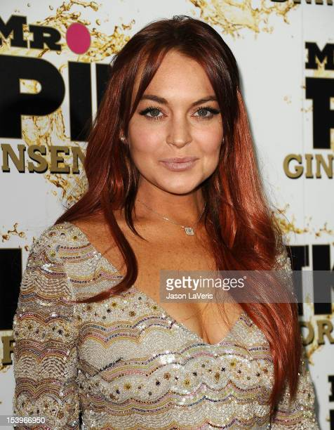 Actress Lindsay Lohan attends the Mr. Pink Ginseng Drink launch party at Regent Beverly Wilshire Hotel on October 11, 2012 in Beverly Hills,...