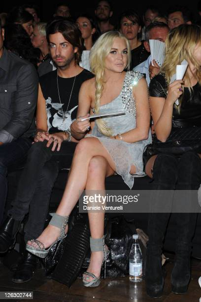 Actress Lindsay Lohan attends the Philipp Plein Urban Jungle show as part of Milan Fashion Week Womenswear Spring/Summer 2012 on September 24, 2011...