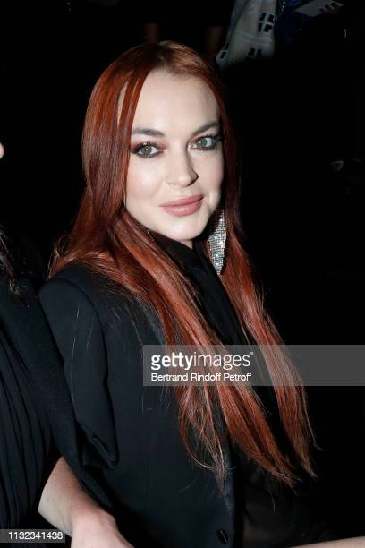 Actress Lindsay Lohan attends the Saint Laurent show as part of the Paris Fashion Week Womenswear Fall/Winter 2019/2020 on February 26 2019 in Paris...