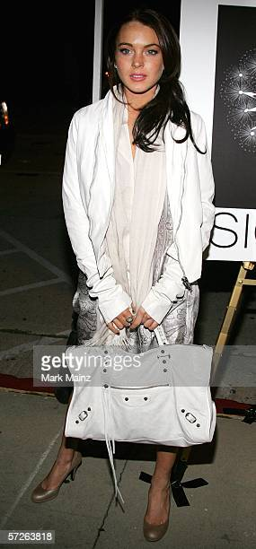 Actress Lindsay Lohan attends the Sienna Los Angeles store opening on April 5, 2006 in Los Angeles, California.