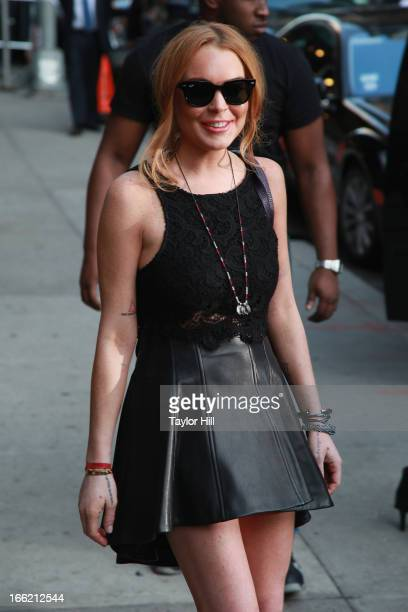 """Actress Lindsay Lohan departs """"Late Show with David Letterman"""" at Ed Sullivan Theater on April 9, 2013 in New York City."""
