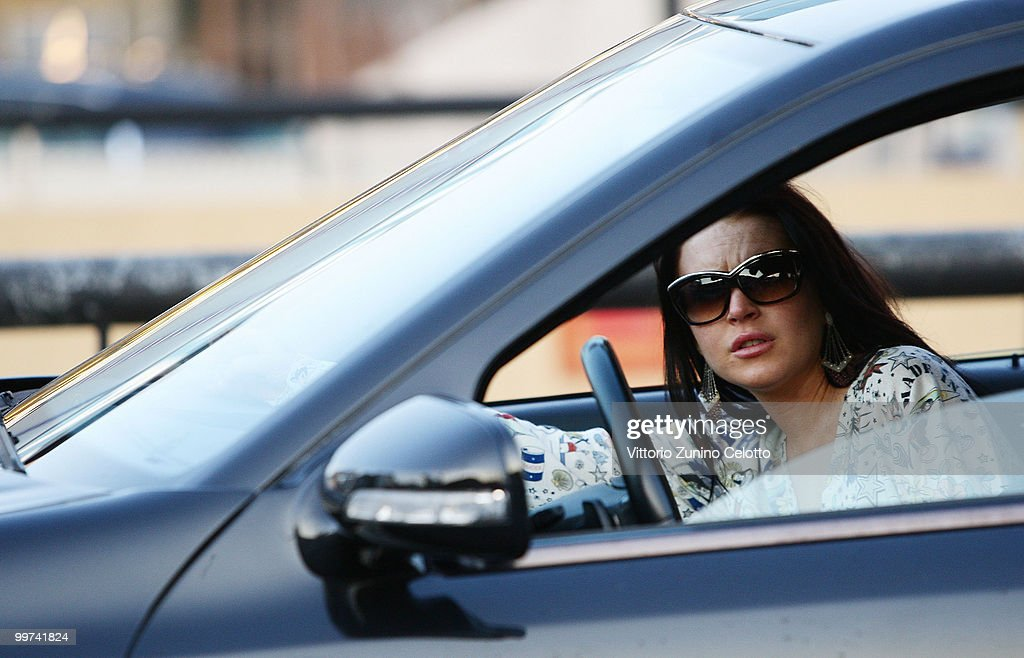 Actress Lindsay Lohan departs to attend Press Meeting aboard Lancia 'Signora Del Vento' on May 17, 2010 in Cannes, France.