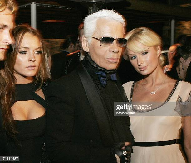 Actress Lindsay Lohan, designer Karl Lagerfeld and Paris Hilton pose at the International Launch of Dom Perignon Rose Vintage 1996 Champagne by Karl...