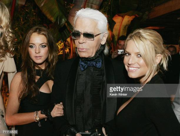 Actress Lindsay Lohan designer Karl Lagerfeld and singer Jessica Simpson pose at the International Launch of Dom Perignon Rose Vintage 1996 Champagne...