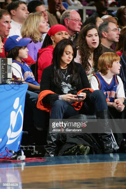 Actress Lindsay Lohan enjoys the game between the New York Knicks and the Utah Jazz on December 23 2005 at Madison Square Garden in New York City The...