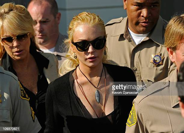Actress Lindsay Lohan , escorted by Los Angeles County Sherriff deputies, and her mother Dina Lohan leave the Airport Courthouse after a preliminary...