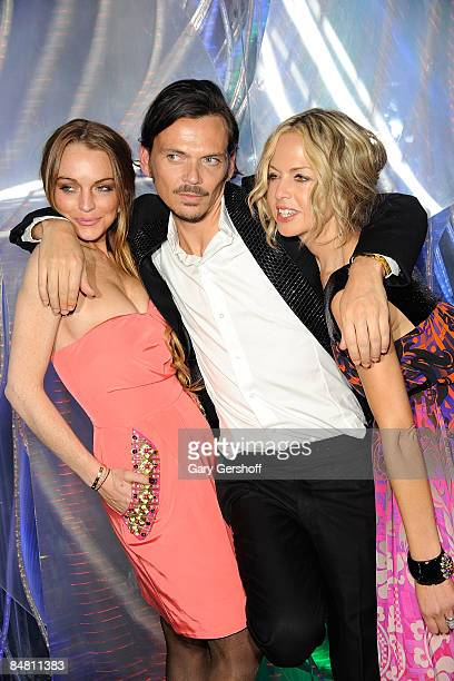 Actress Lindsay Lohan, fashion designer Matthew Williamson, and celebrity stylist, Rachel Zoe, attends the New York store opening celebration for...