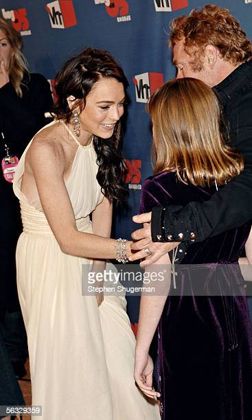 Actress Lindsay Lohan greets actor Danny Bonaduce and his daughter Isabella Bonaduce as they arrive at the VH1 Big In '05 Awards held at Stage 15 on...