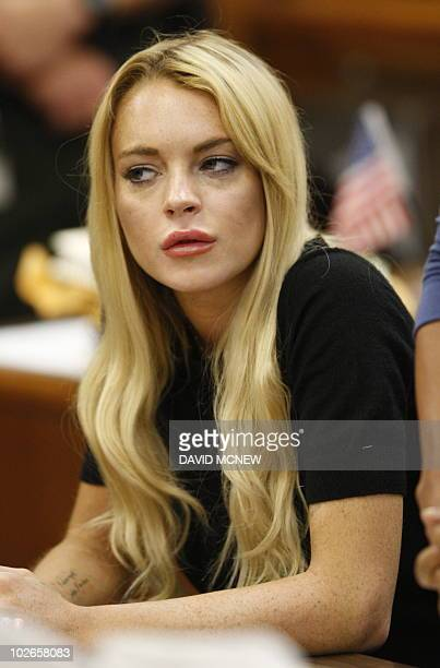 US actress Lindsay Lohan listens to Judge Marsha Revel during her hearing at the Beverly Hills Courthouse on July 6 2010 Lohan was arrested in 2007...
