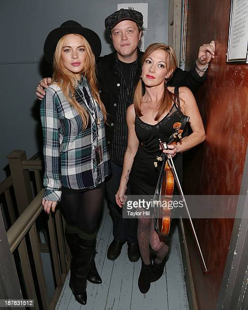 Actress Lindsay Lohan musician Jason Isbell and violinist Amanda Shires attend Dylan Fest NYC 2013>> at the Bowery Ballroom on November 12 2013 in...