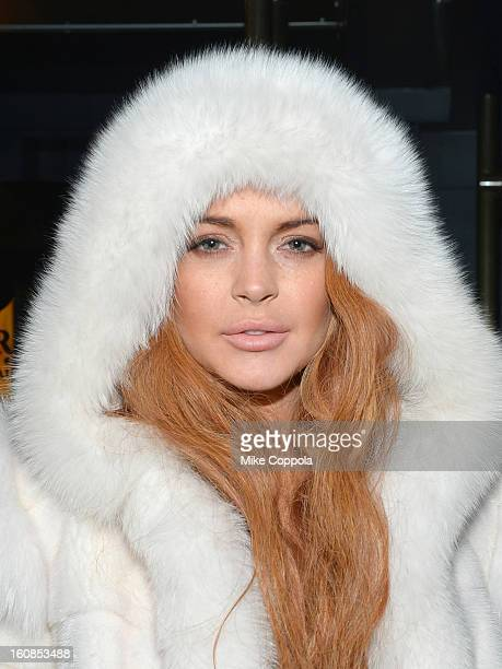 Actress Lindsay Lohan poses outside of the amfAR Gala after party in celebration of MercedesBenz Fashion Week at SL on February 6 2013 in New York...