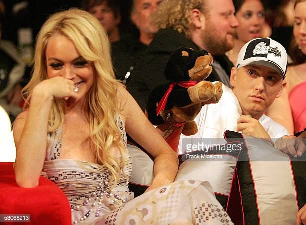 Actress Lindsay Lohan reacts to the insult dog performed by Eminem during the 2005 MTV Movie Awards at the Shrine Auditorium June 4 2005 in Los...