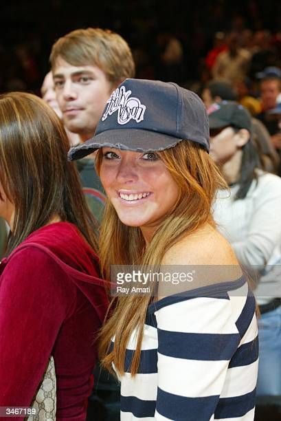 Actress Lindsay Lohan sits courtside during Game four of the Eastern Conference Quarterfinals of the 2004 NBA Playoffs between the New York Knicks...