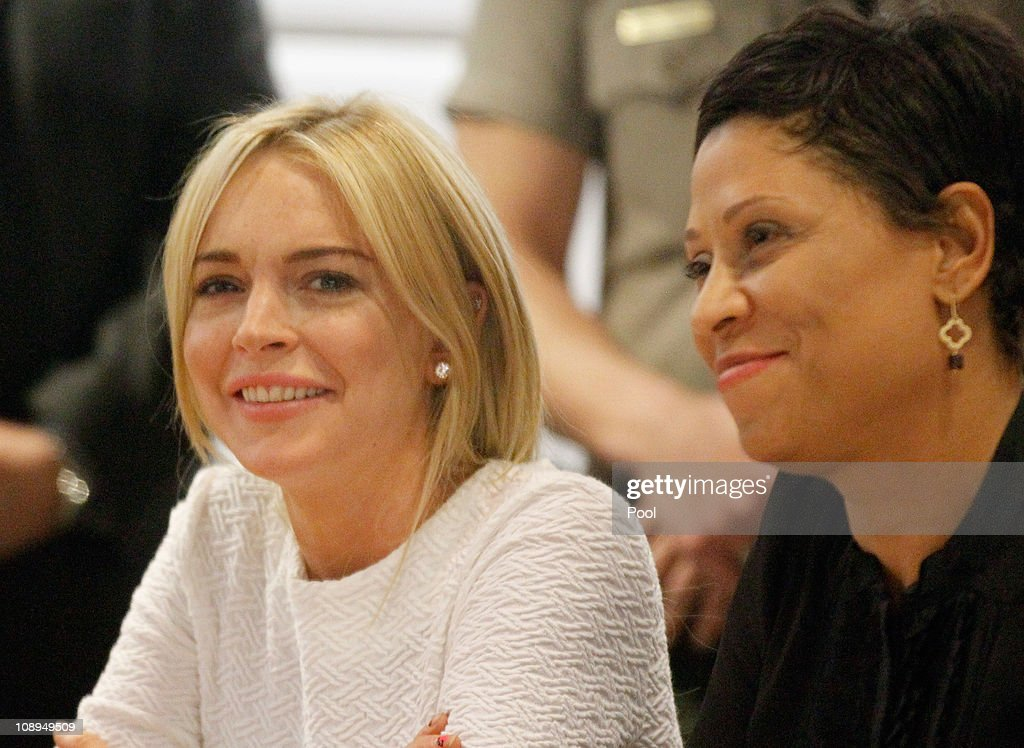 Actress Lindsay Lohan (L) sits with her attorney Shawn Chapman Holley during her arraignment for a felony count of grand theft on February 9, 2011 in Los Angeles, California. Lohan was charged with a felony count of grand theft for allegedly stealing a $2,500 necklace from a jewelry store in Venice.