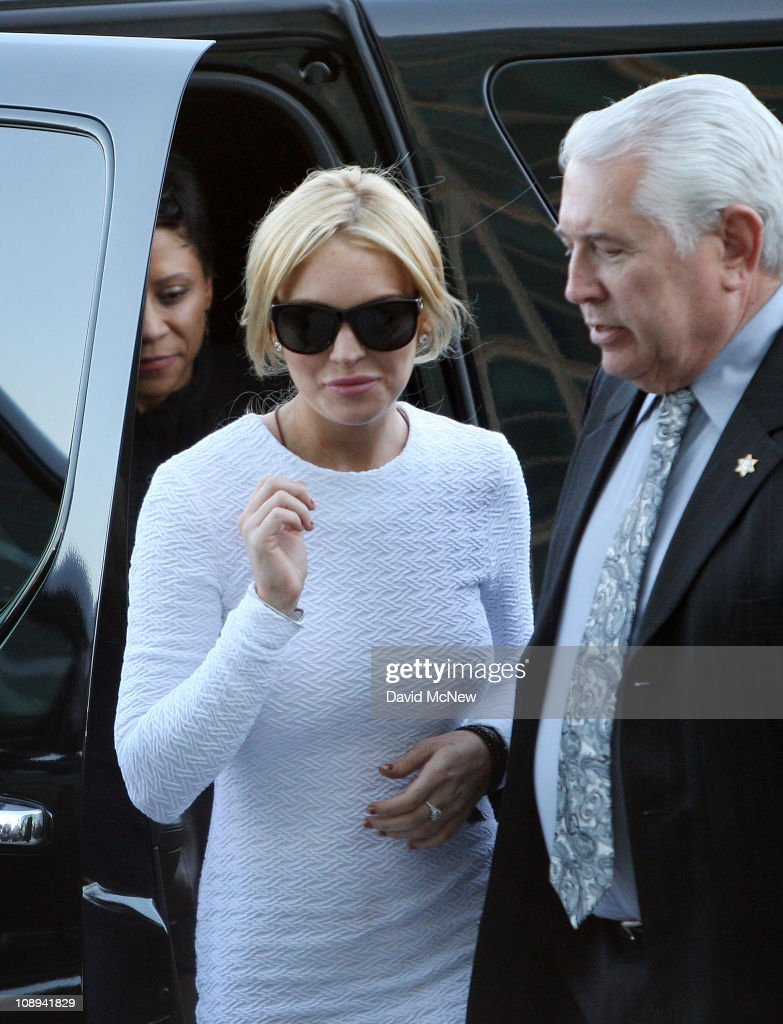 Actress Lindsay Lohan steps from the car as she arrives to court for an arraignment hearing in connection with the alleged theft of a $2,500 necklace on February 9, 2011 in Los Angeles, California. Lohan has been charged with a felony count of grand theft for allegedly walking out of a Venice, California store with the necklace in January.