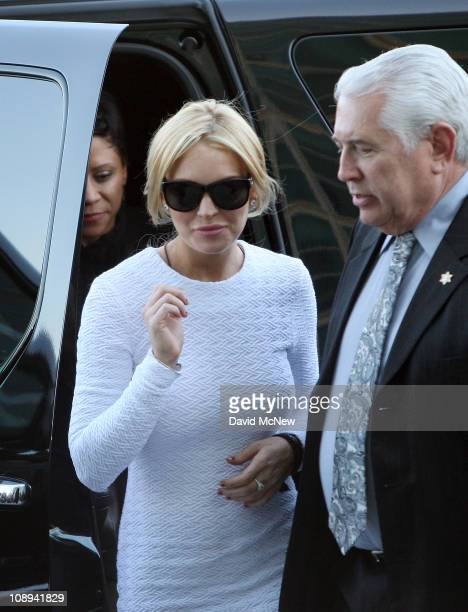 Actress Lindsay Lohan steps from the car as she arrives to court for an arraignment hearing in connection with the alleged theft of a $2500 necklace...